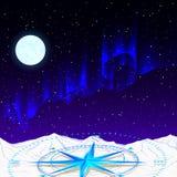 Une boussole bleue rougeoyante dans la perspective du ciel étoilé, image stock