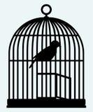 Une cage à oiseaux et un oiseau ouverts Photo libre de droits