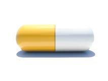 Une capsule jaune et blanche d'isolement Image stock