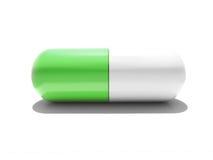 Une capsule verte et blanche d'isolement Images libres de droits