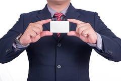 Une carte de visite professionnelle de visite de offre d'homme d'affaires Image libre de droits