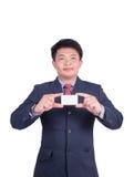 Une carte de visite professionnelle de visite de offre d'homme d'affaires Photographie stock