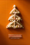 Une carte postale avec une photo d'un arbre de Noël de biscuit Photo libre de droits