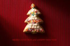 Une carte postale avec une photo d'un arbre de Noël de biscuit Image stock