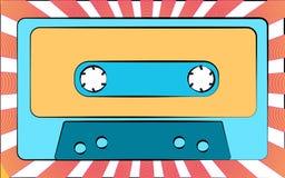 Une cassette sonore de vieille rétro de vintage d'antiquité musique bleue de hippie pour un magnétophone sur un fond des faisceau Image libre de droits