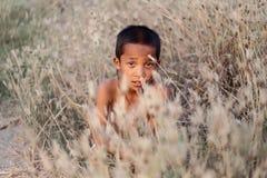 Une coiffure antique thaïlandaise de garçon Image stock