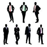 Une collection de 7 silhouettes de vecteur d'hommes d'affaires Photos stock