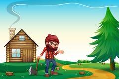 Une colline avec une maison en bois et un bûcheron Photographie stock libre de droits