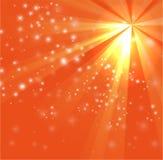 Une conception orange de couleur avec un éclat et des rayons Image libre de droits