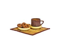 Une cuvette de café et de biscuits images stock