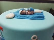 Une décoration miniature de gâteau de bébé Photographie stock