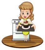 Une dame faisant un petit gâteau cuire au four illustration libre de droits