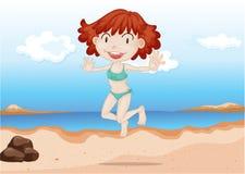 Une danse de fille sur la plage Images libres de droits