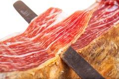 Découpage en tranches de l'iberico espagnol de jamon Image libre de droits