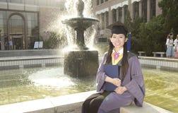 Une diplômée de fille Photographie stock libre de droits