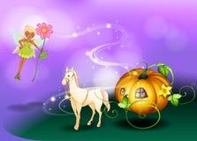 Une fée tenant une fleur avec un chariot de potiron Images stock