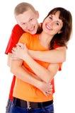 Une famille heureuse, étreindre de couples Images libres de droits