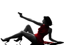 Femme sexy tenant la silhouette d'arme à feu Images libres de droits