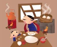 Une femme chinoise de village préparant la boulette dans la cuisine Photos stock