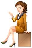Une femme d'affaires s'asseyant Photos stock