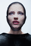 Une femme dans un voile noir Photos libres de droits