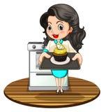 Une femme faisant un petit gâteau cuire au four illustration libre de droits
