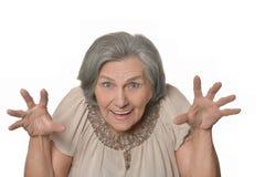Une femme plus âgée est heureusement étonnée Photo stock