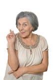 Une femme plus âgée est heureusement Image stock