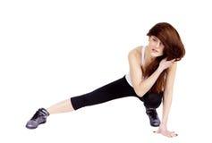 Une femme s'exerce Forme physique Photos libres de droits