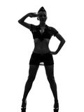 Femme sexy en silhouette de salutation uniforme d'armée Photo libre de droits