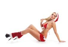 Une femme sexy posant dans Noël érotique vêtx Photos libres de droits