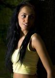 Une fille dans l'obscurité Photographie stock libre de droits