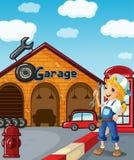Une fille dans le garage Photo libre de droits
