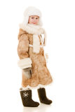 Une fille dans un sourire de manteau de fourrure et de chapeau Image libre de droits