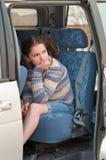 Une fille dans un véhicule Photos libres de droits