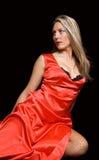 Une fille dans une robe rouge Image stock