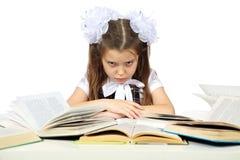 Une fille et livres Photos stock