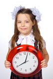 Une fille et une horloge Photos libres de droits