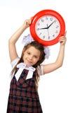 Une fille et une horloge Photos stock
