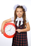 Une fille et une horloge Photo stock