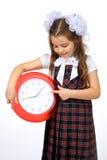 Une fille et une horloge Photo libre de droits