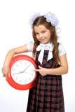 Une fille et une horloge Image libre de droits