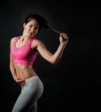 Une fille fait une forme physique Photos stock