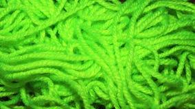 Une fin vers le haut d'image de fil texturisé, couleur verte Photo stock