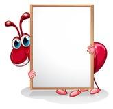 Une fourmi tenant un tableau blanc vide Image libre de droits