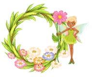 Une frontière ronde avec une fée tenant une fleur Photographie stock