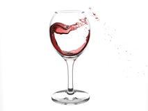 Une glace avec l'éclaboussure du vin rouge Photographie stock