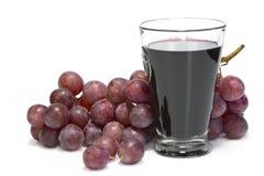 Une glace de jus de raisins et groupe de raisins. Images stock