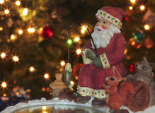 Une glace pêchant Santa et amis velus Image stock