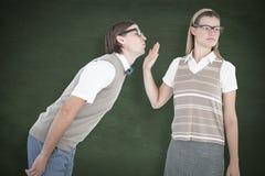 Une image composée de hippie geeky faisant un signe d'arrêt à son ami Photo stock